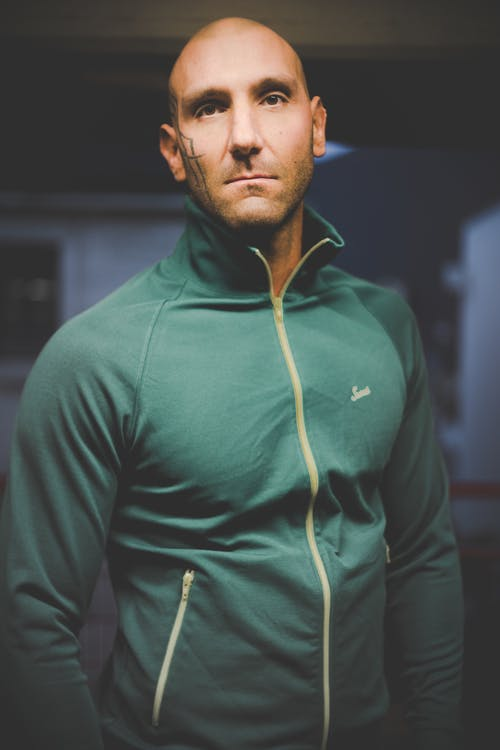 Photo of Man in Green Zip-up Jacket