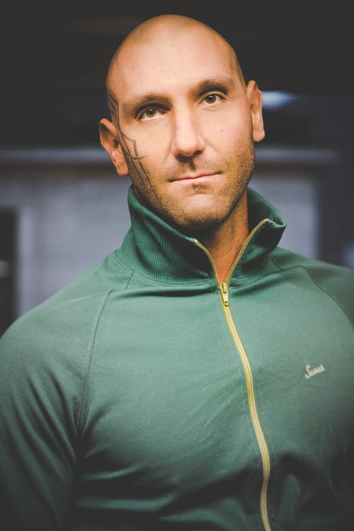 Man Wearing Green Zip-up Top