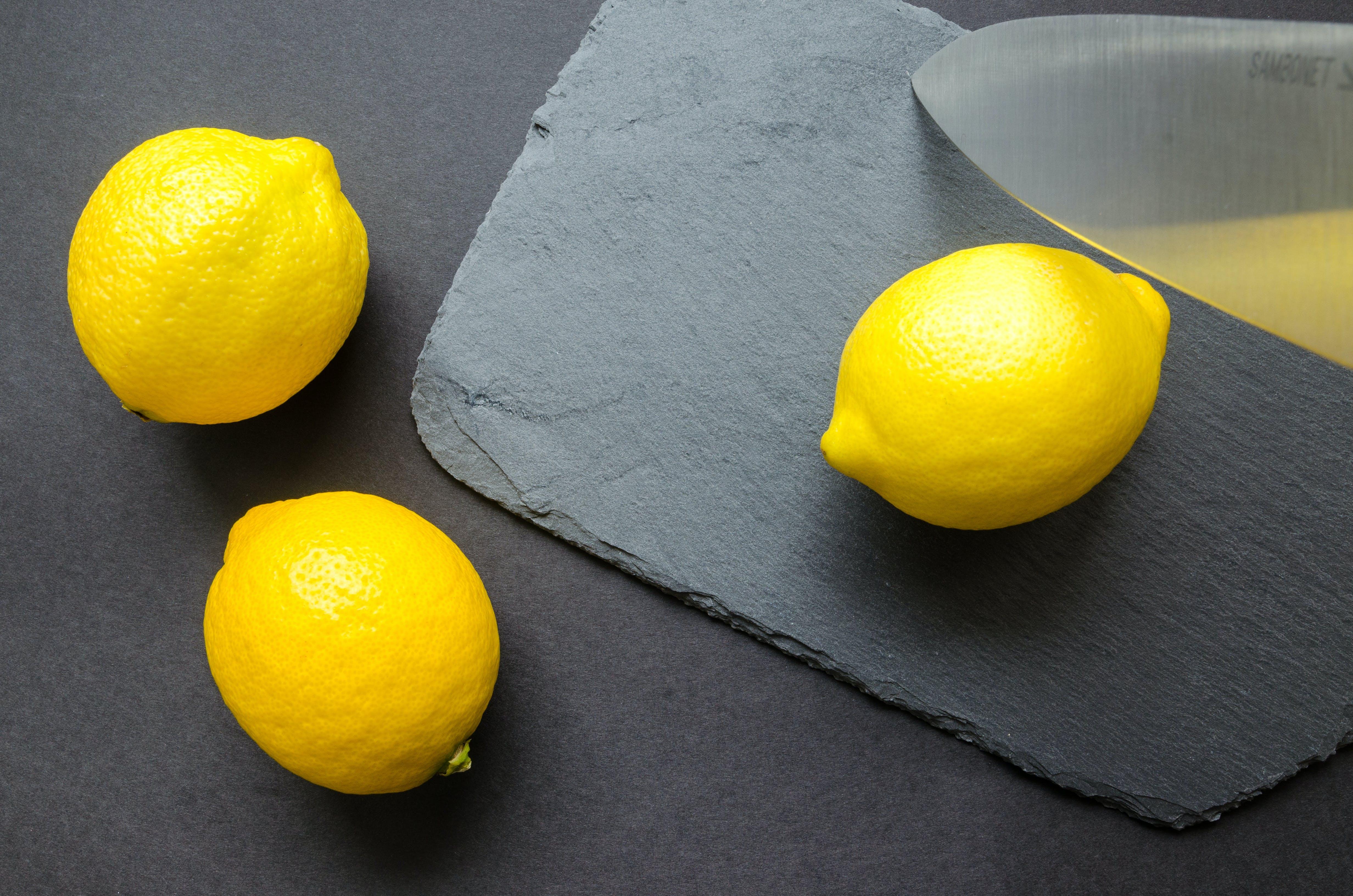 Three Lemons on Grey Surface