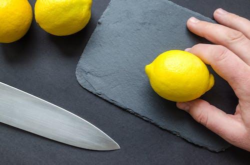 Person Holding A Lemon