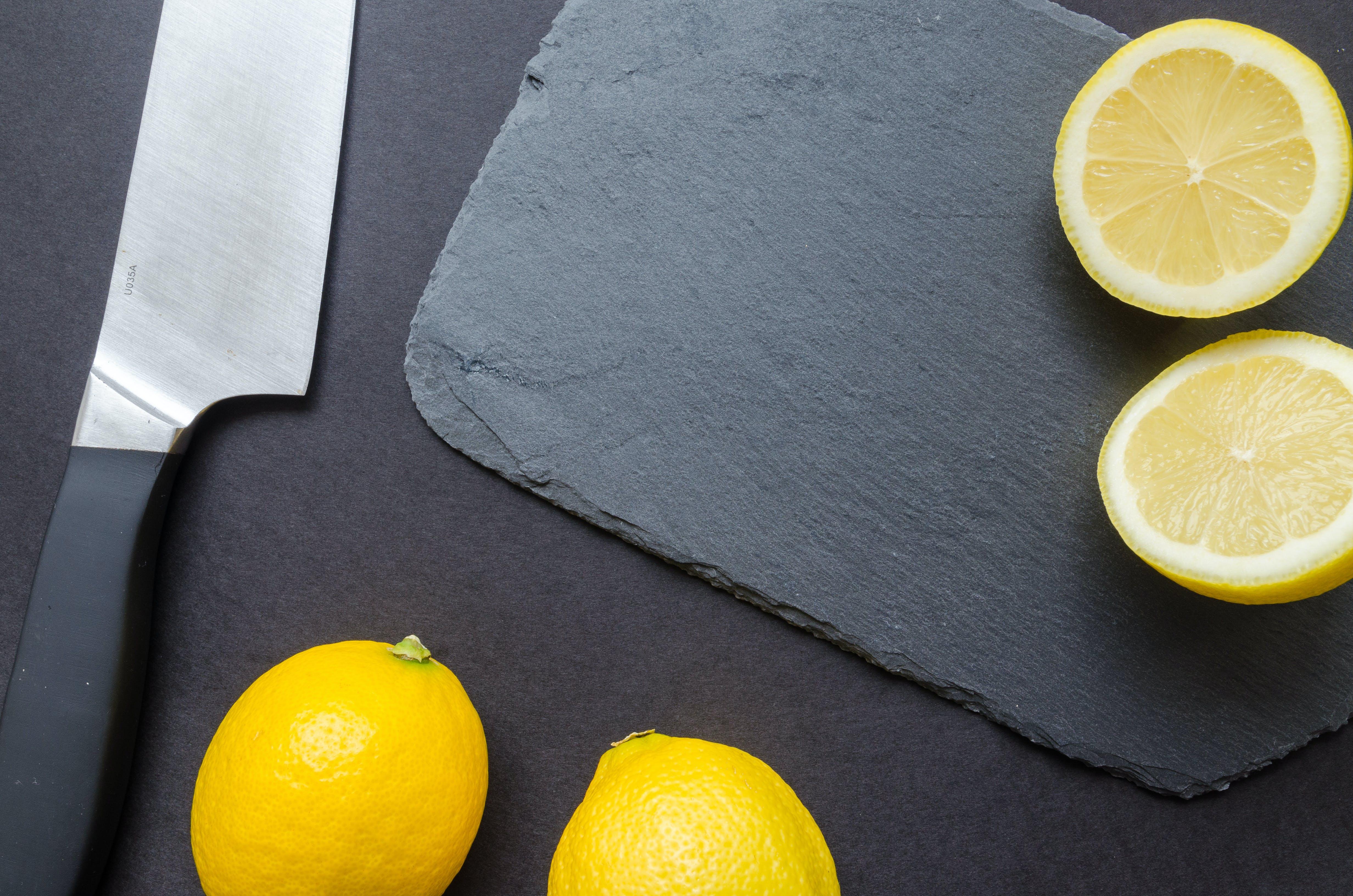 Photography of Sliced Lemon Near Kitchen Knife