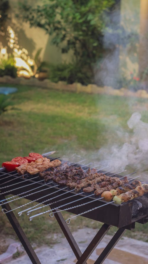 Photo of Skewers with Meat on a Griller