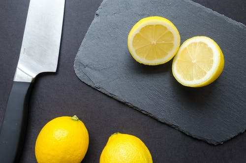 Sliced Lemons on Black Surface
