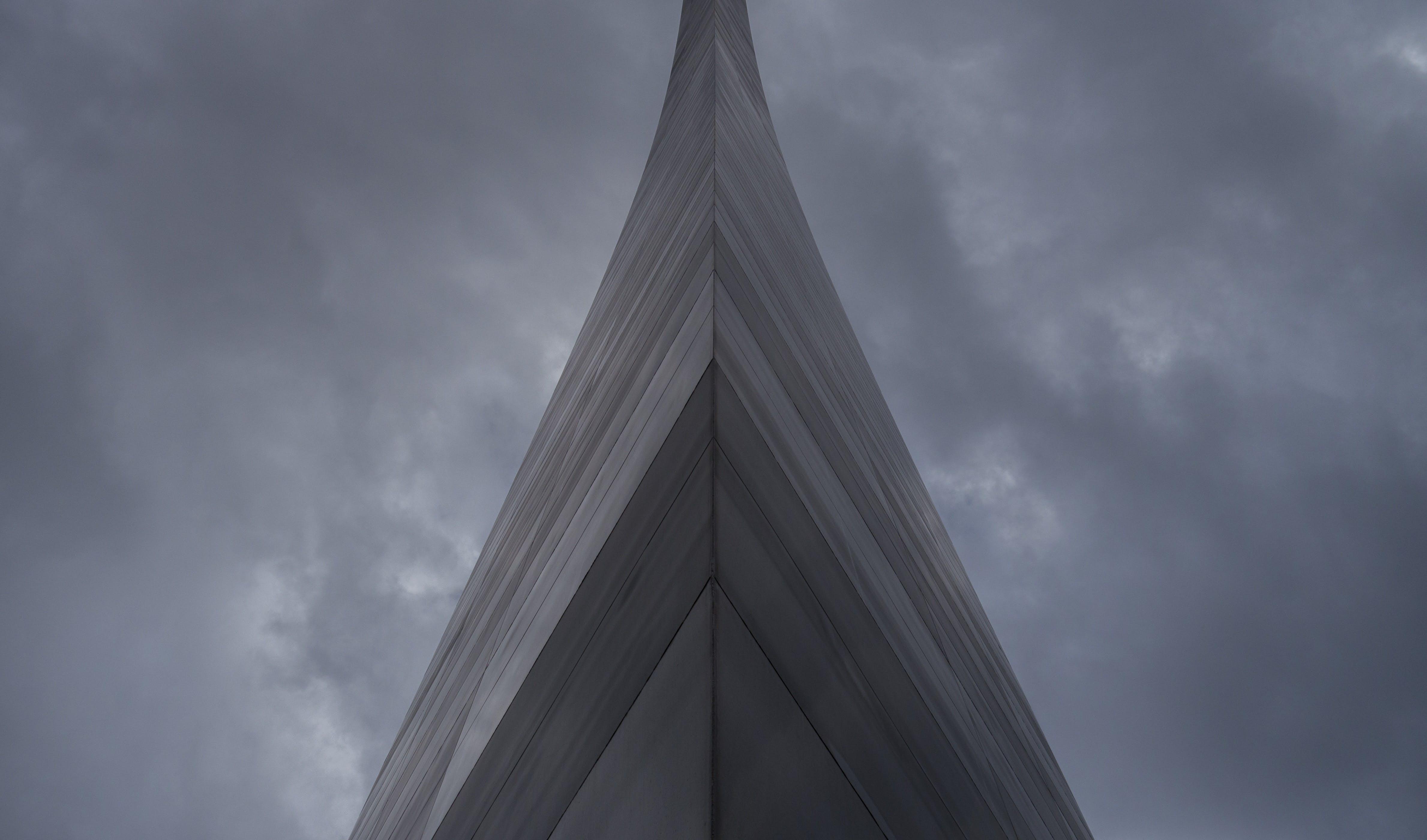 Gray Building Under Dark Clouds