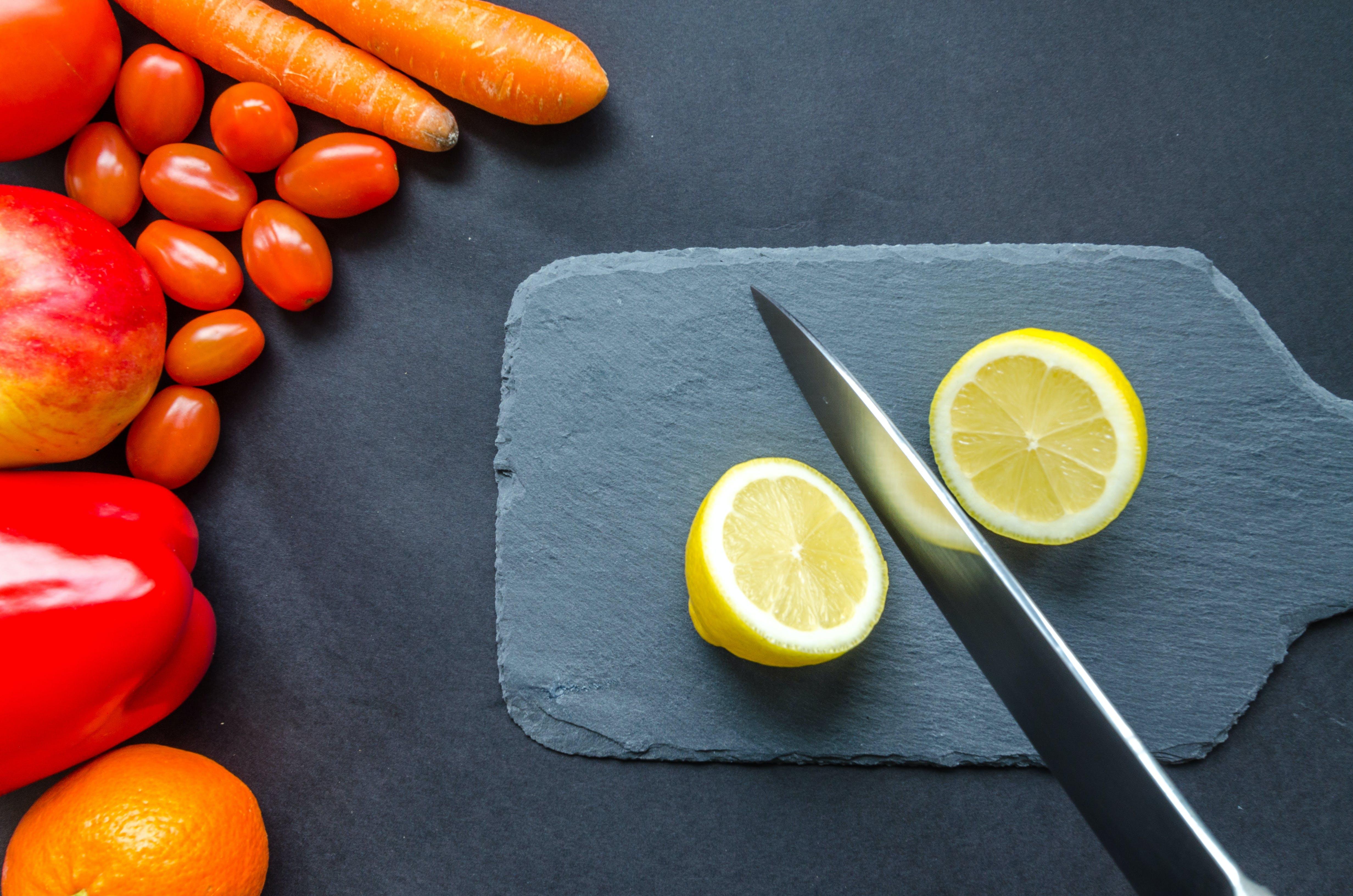 Sliced Lemon on Gray Chopping Board