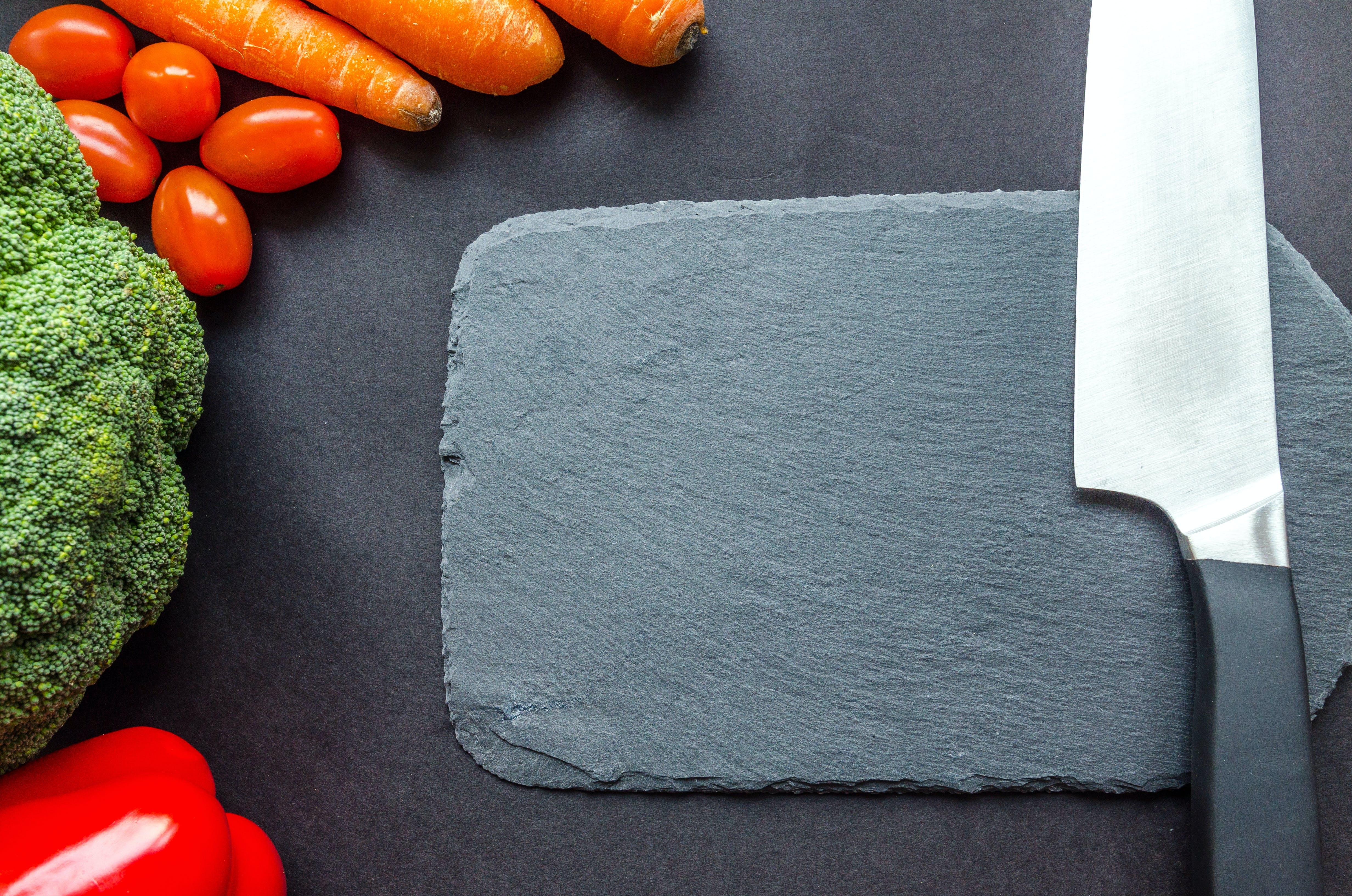 Black Handle Knife Near the Carrots