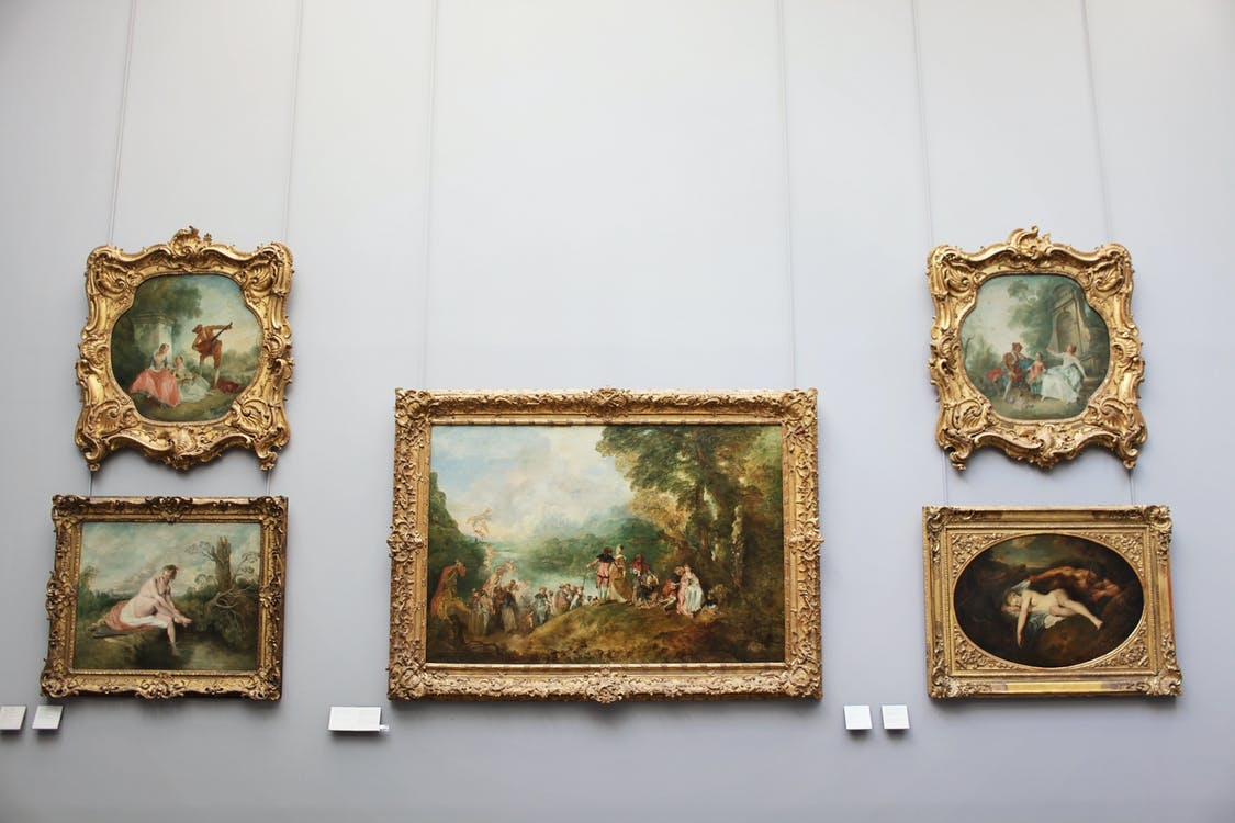Five Brown Ornate Frames On Wall