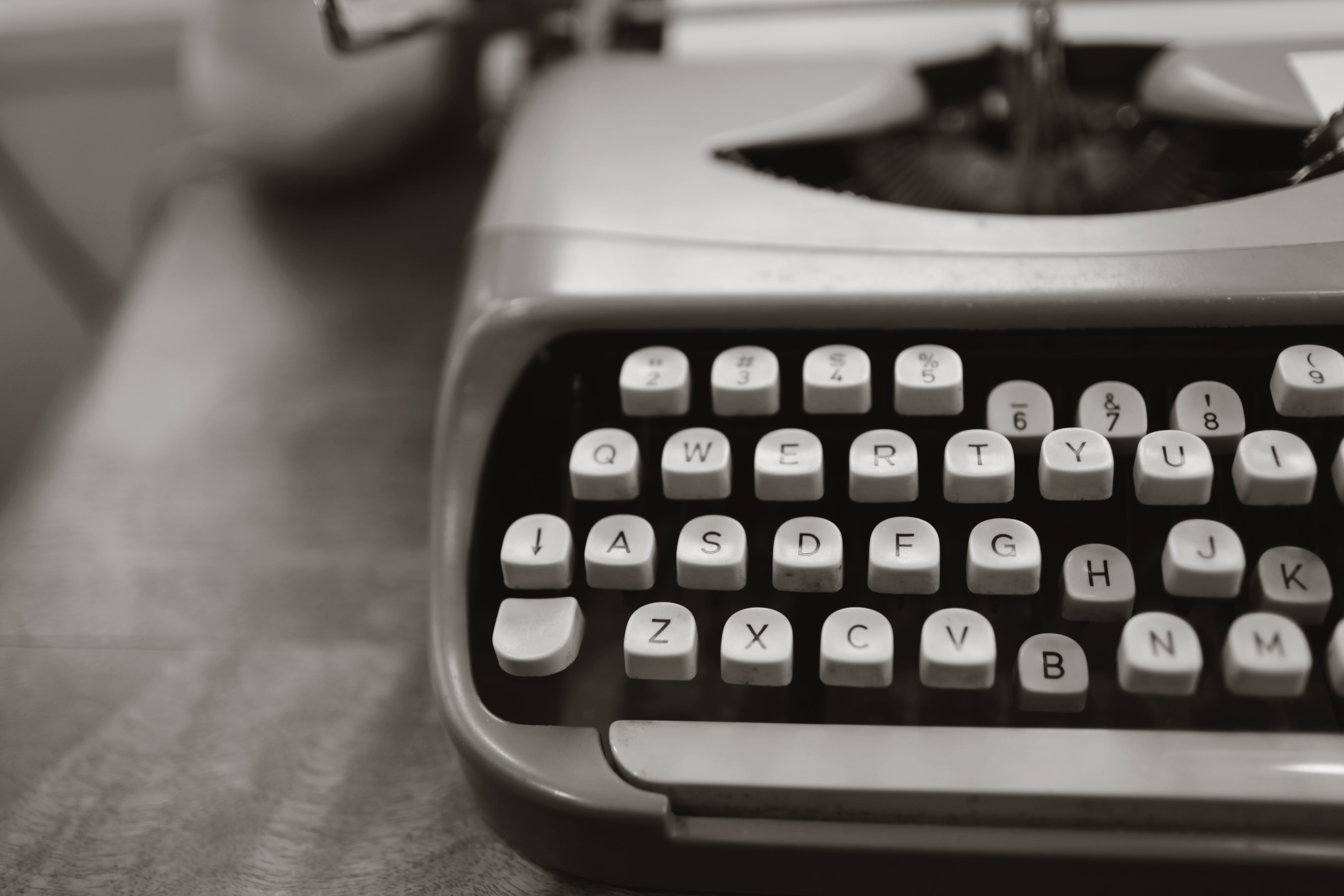 Close-up Photo of Gray Typewriter