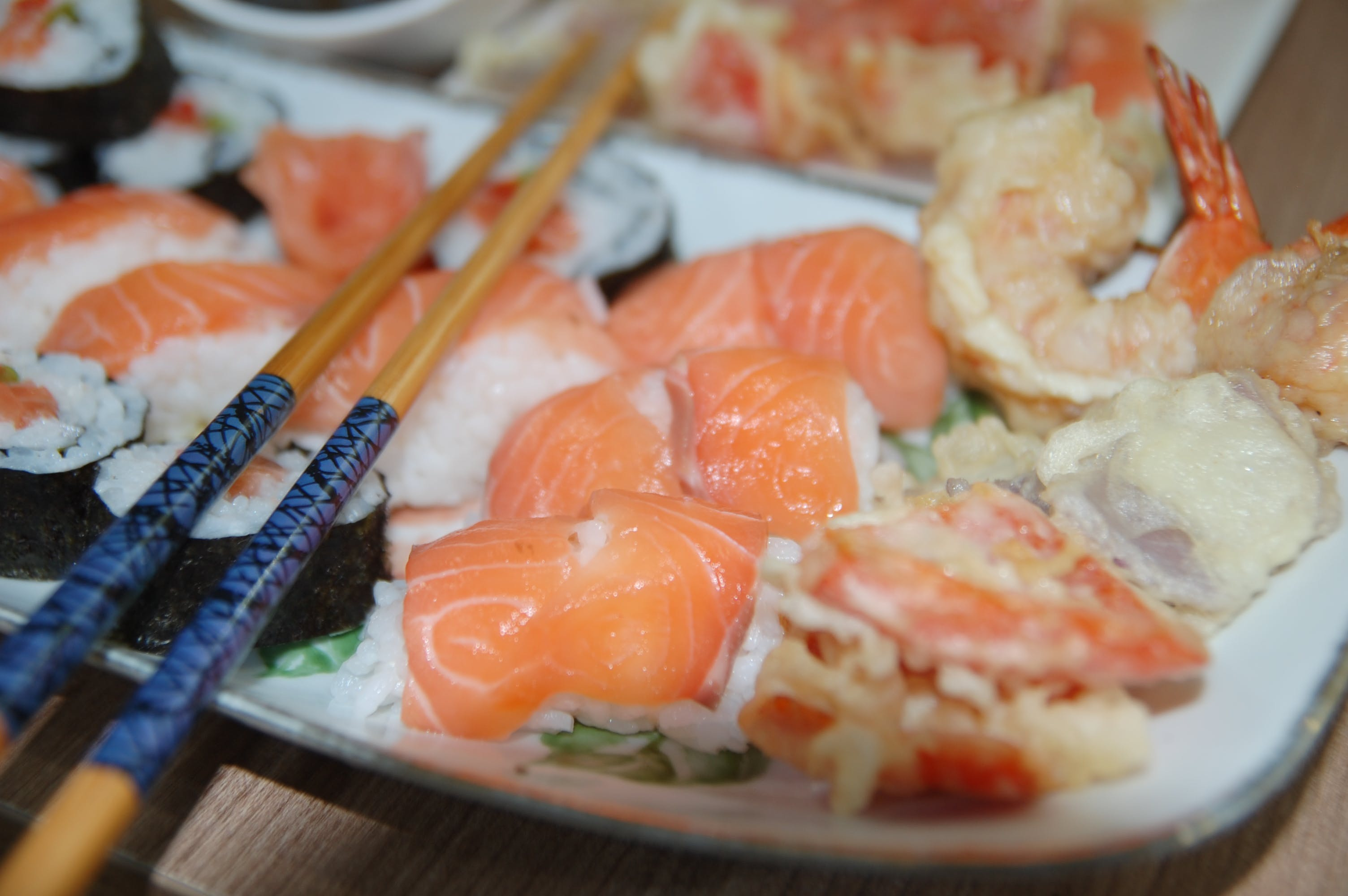 Chopsticks on Top of Variety of Sushi on Plate