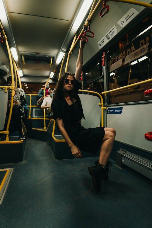 Woman in Black Long Sleeve Shirt Sitting on Train