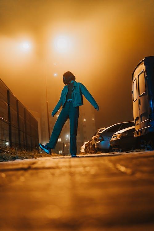 Man in Blue Suit Standing Beside Blue Car