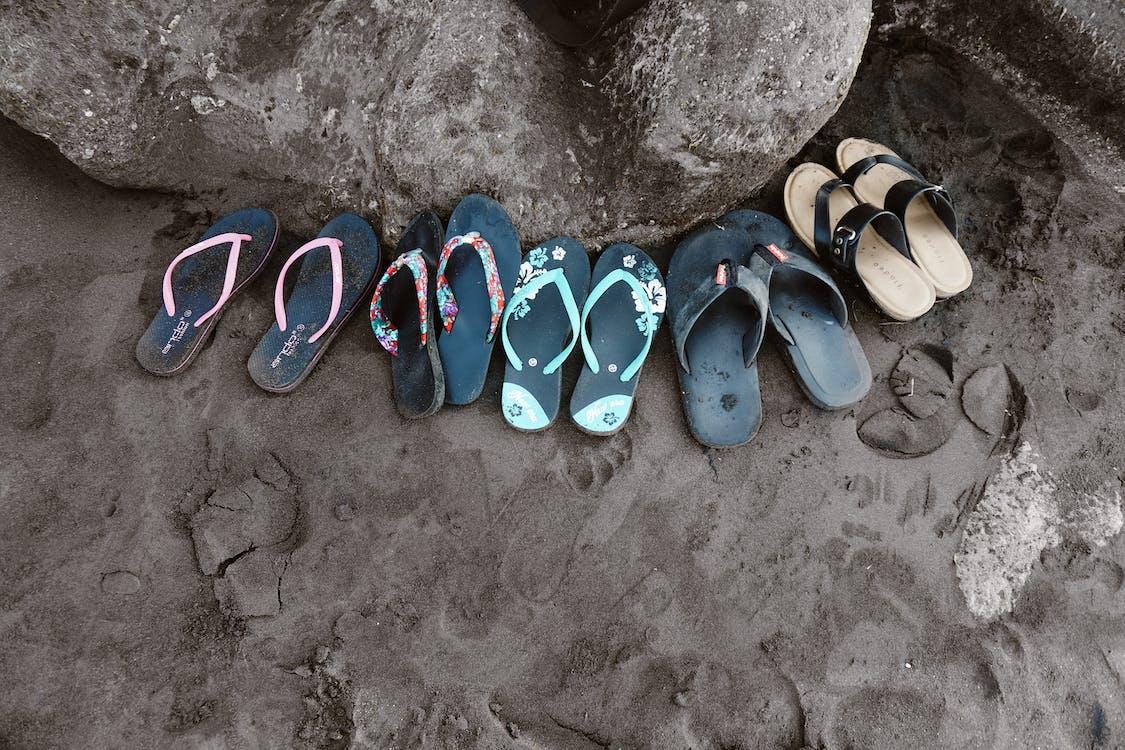 Assorted Flip-flops on Sand