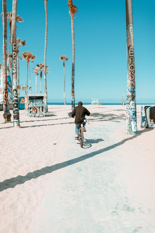 Free stock photo of adult, beach, bicycle