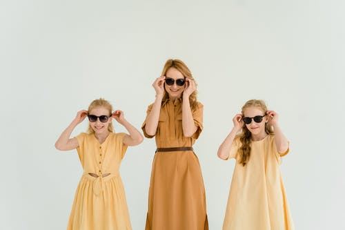 Mother with Her Two Girls Wearing Sunglasses