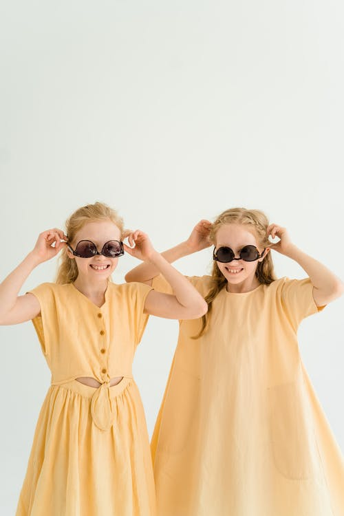 Two Girls Wearing their Sunglasses Upside Down