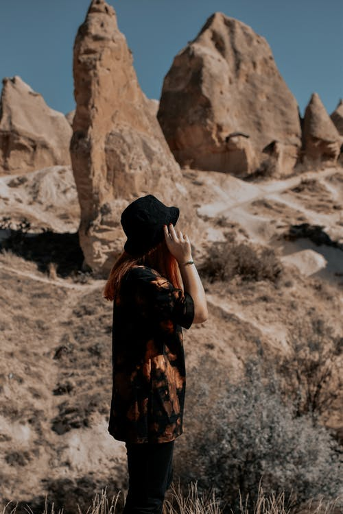 A Person Standing Near the Rock Formations