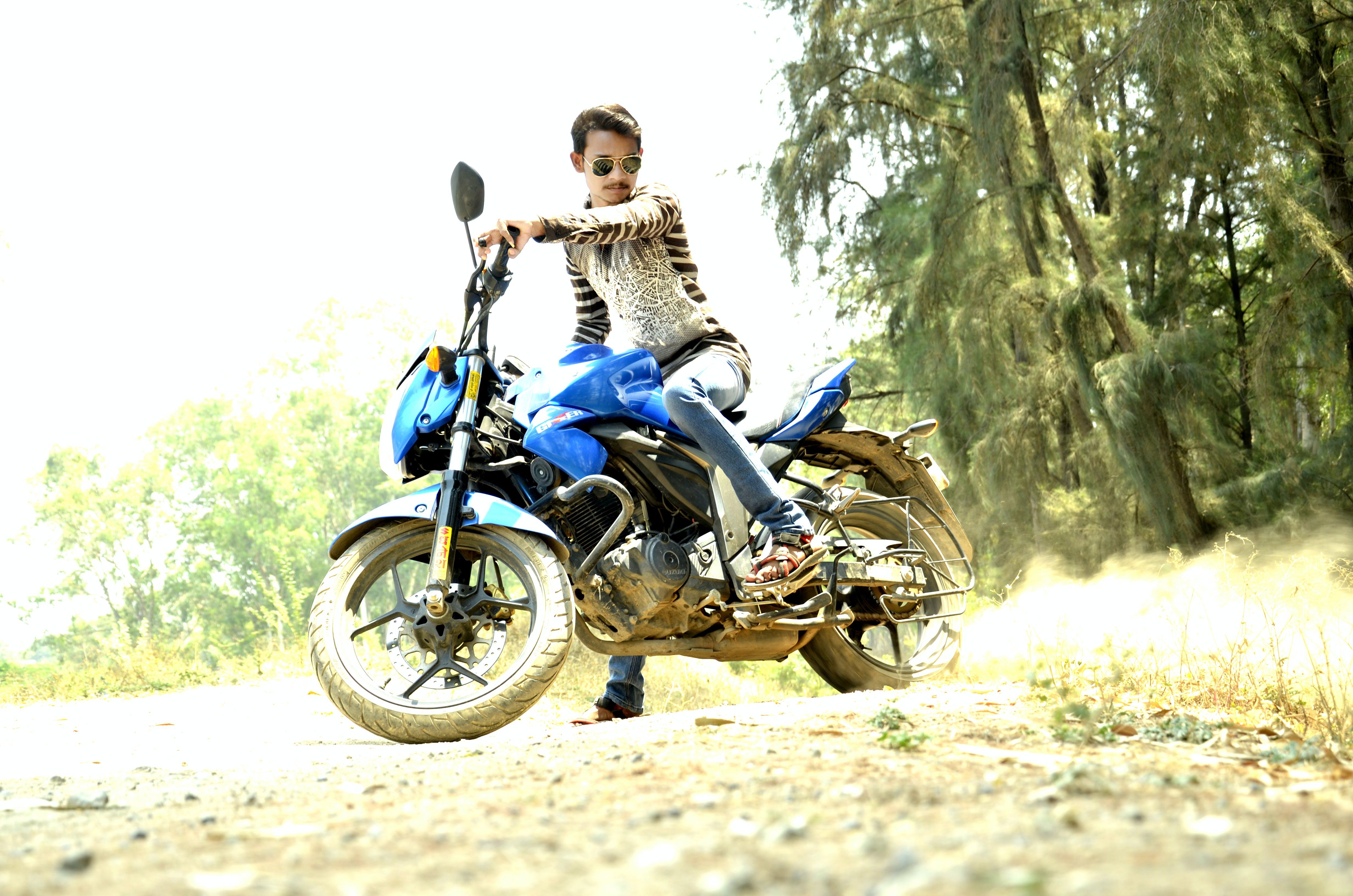 Man Riding Blue Sports Bike