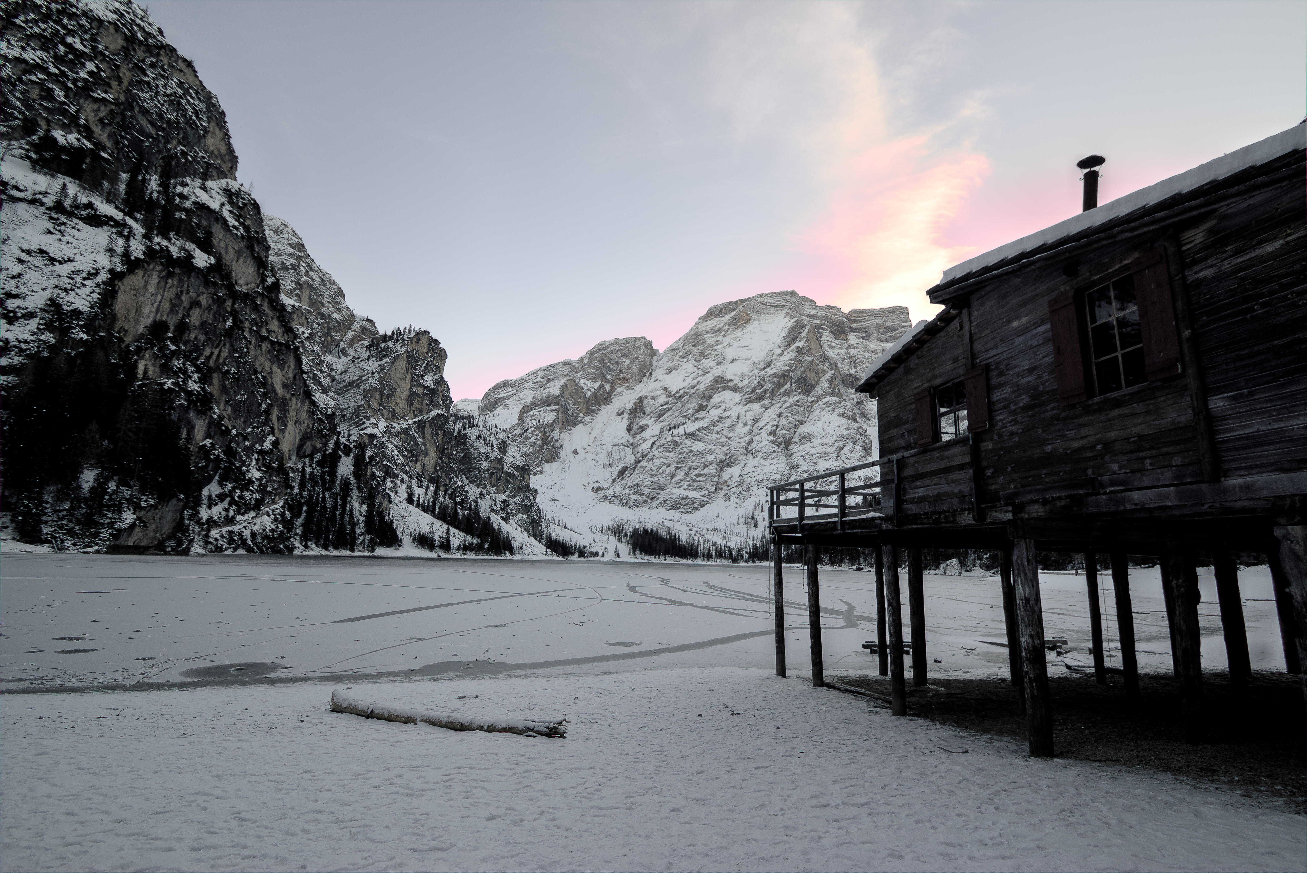 Wooden House Near Mountain Covered With Snow