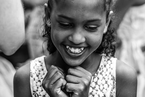 Grayscale Photography of a Pretty Smiling Girl