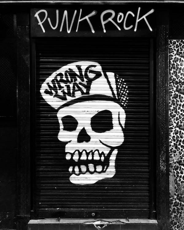 Funky skull graffiti on locked roll down black door
