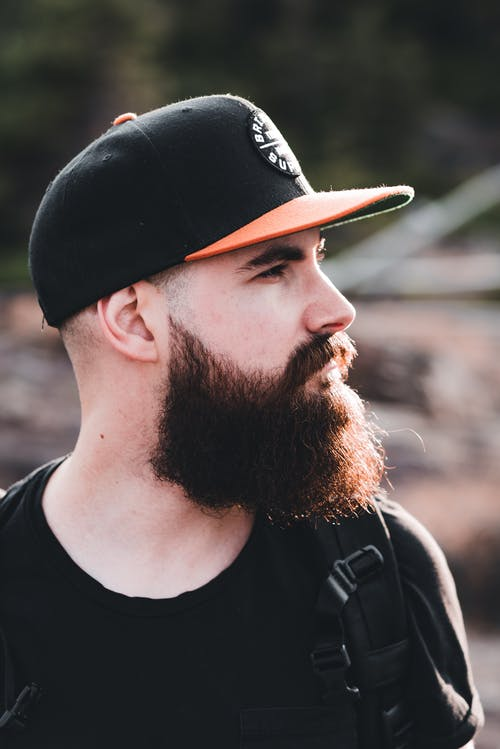 Side View of Full Beard Man Wearing a Cap