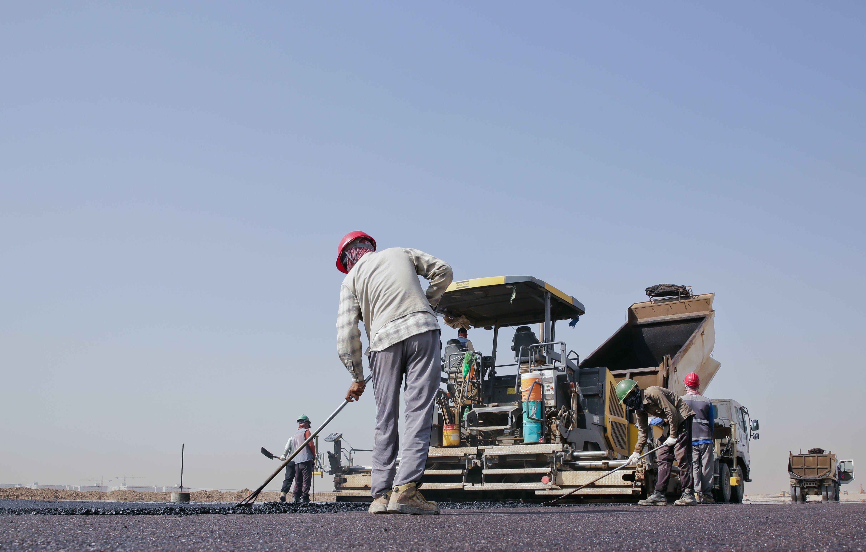 Group of Men Repairing a Road