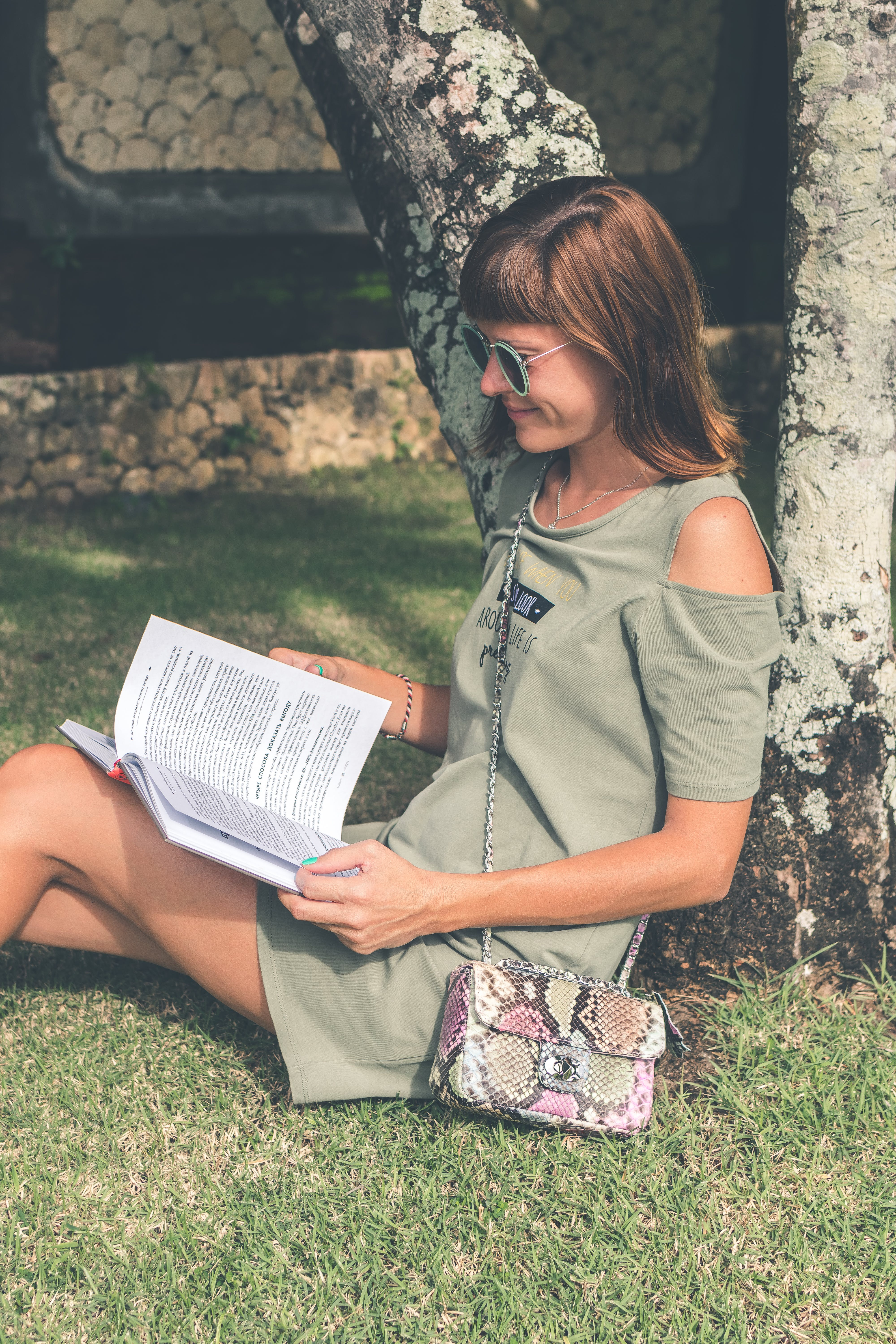 Woman in Gray Dress Reading Book at Daytime