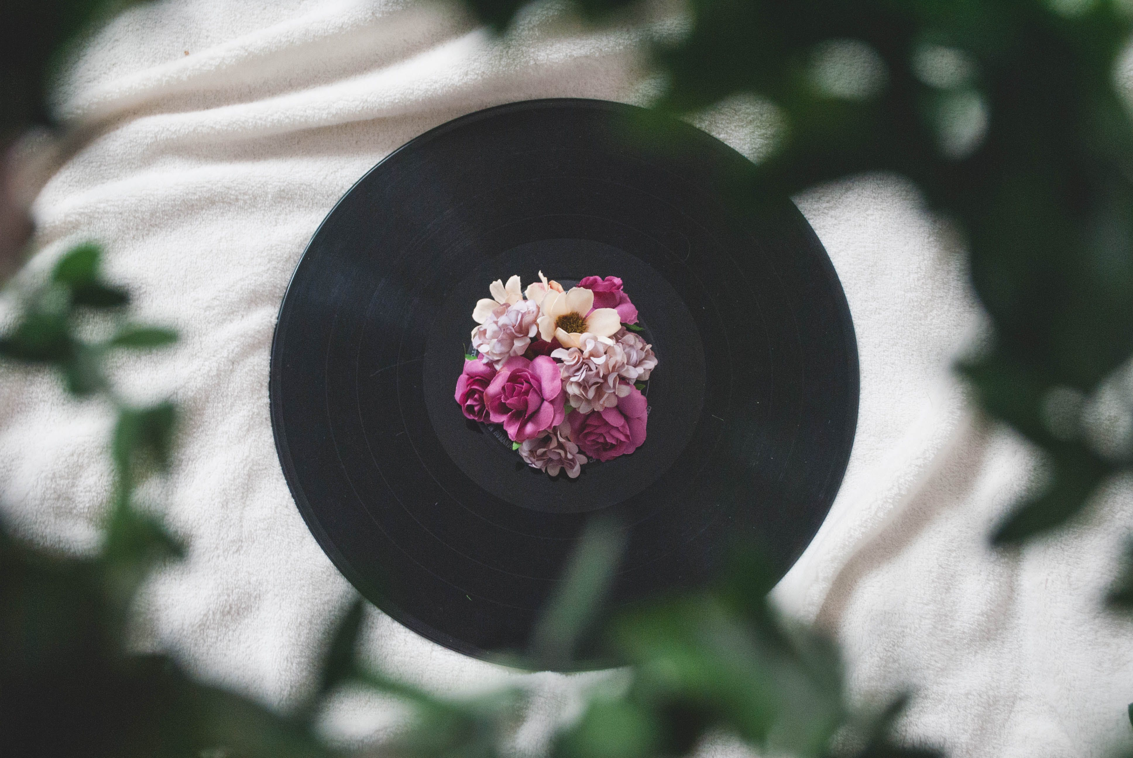 Photography of Flowers On Top of Vinyl Record