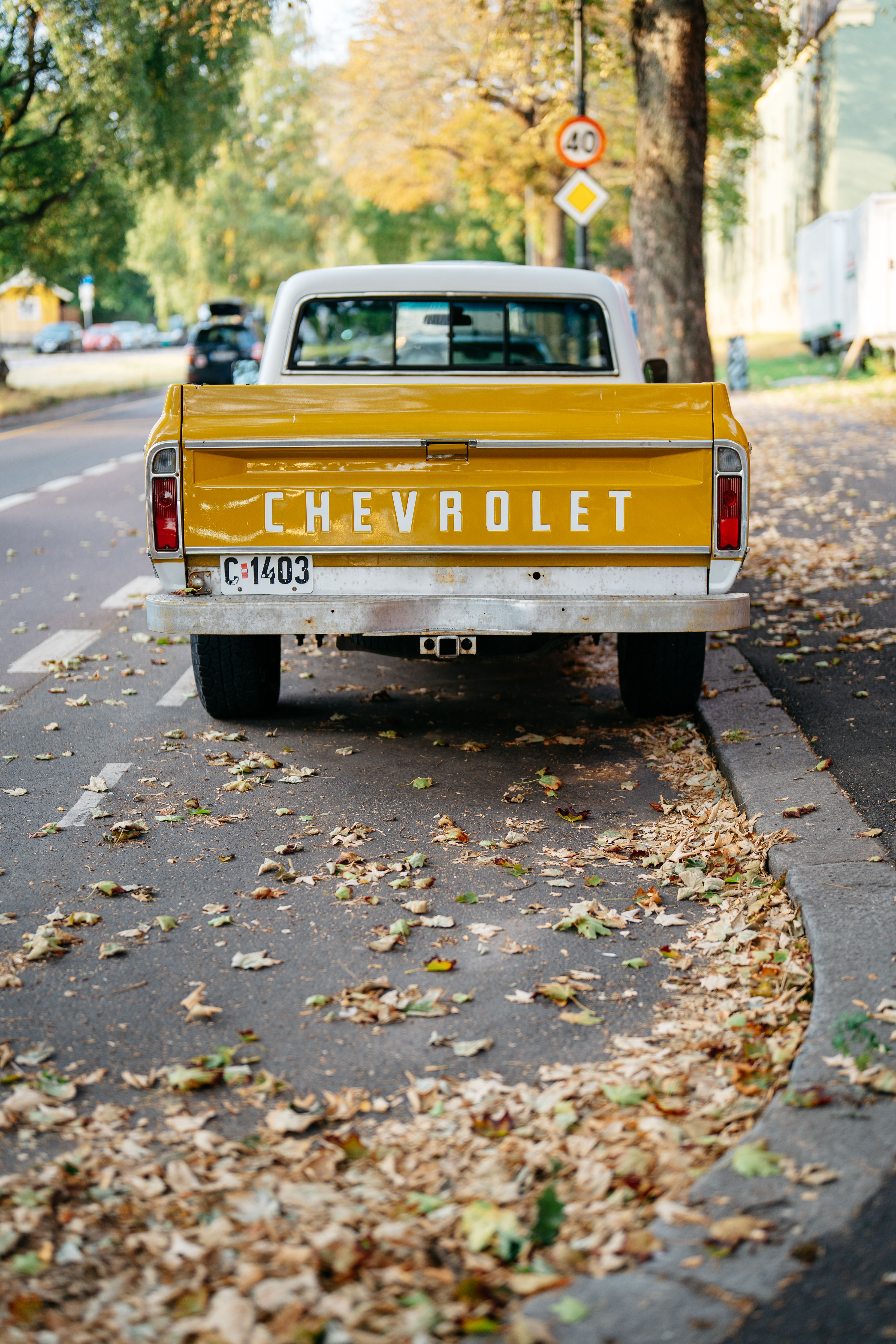 yellow chevrolet crew cab pickup truck on road