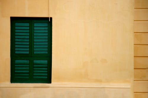 Free stock photo of green window, shop window, window blinds, yellow wall