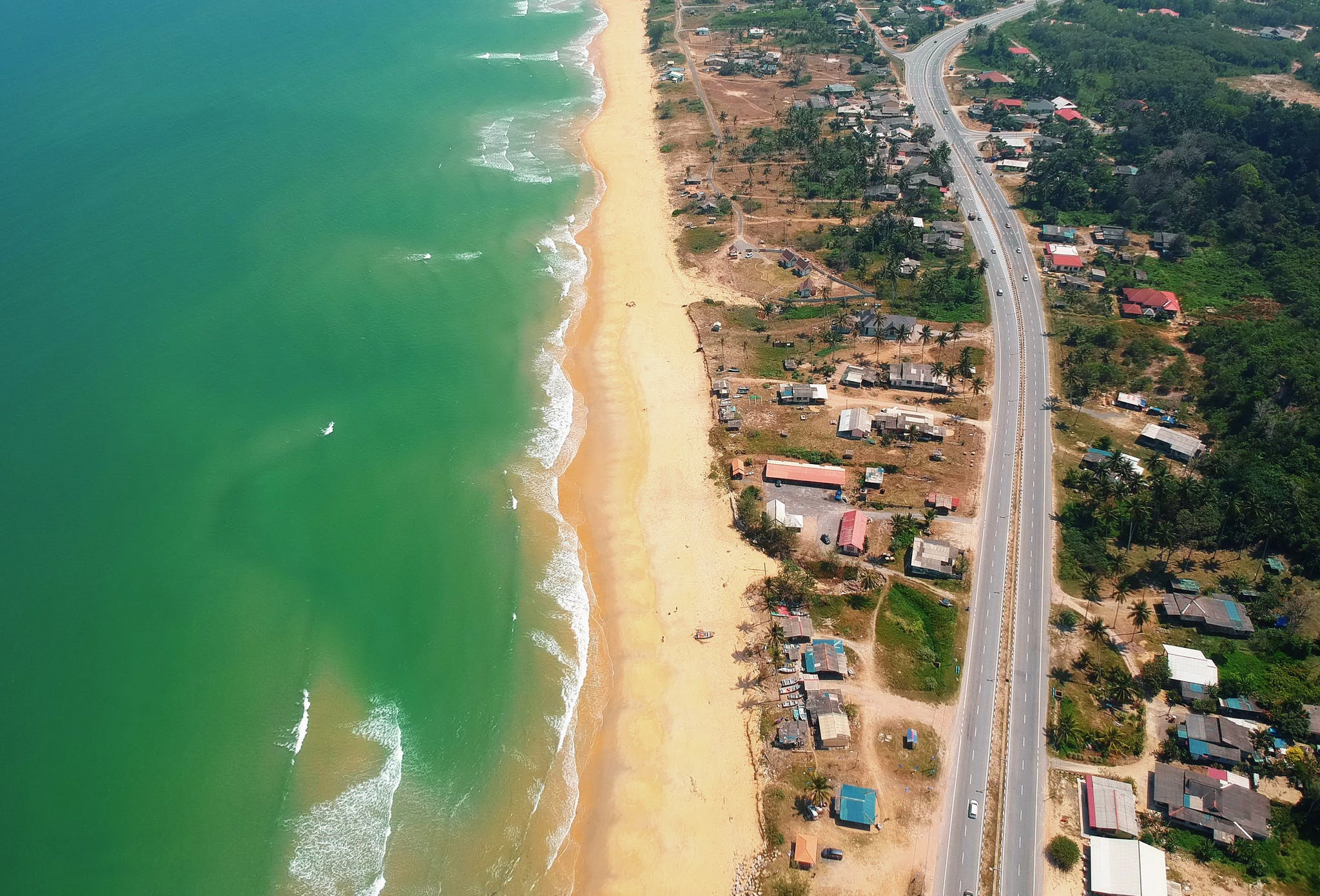 Top View of Blue Sea and Brown Sand