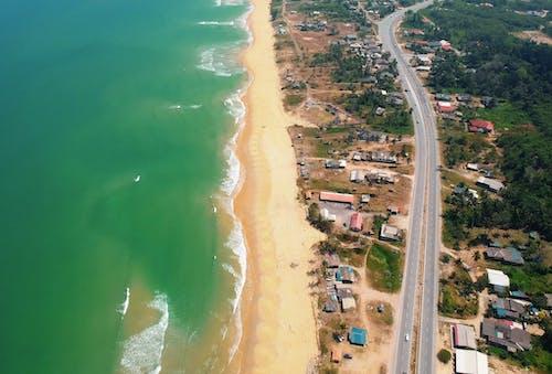 Ilmainen kuvapankkikuva tunnisteilla aallot, arkkitehtuuri, autot, hiekka