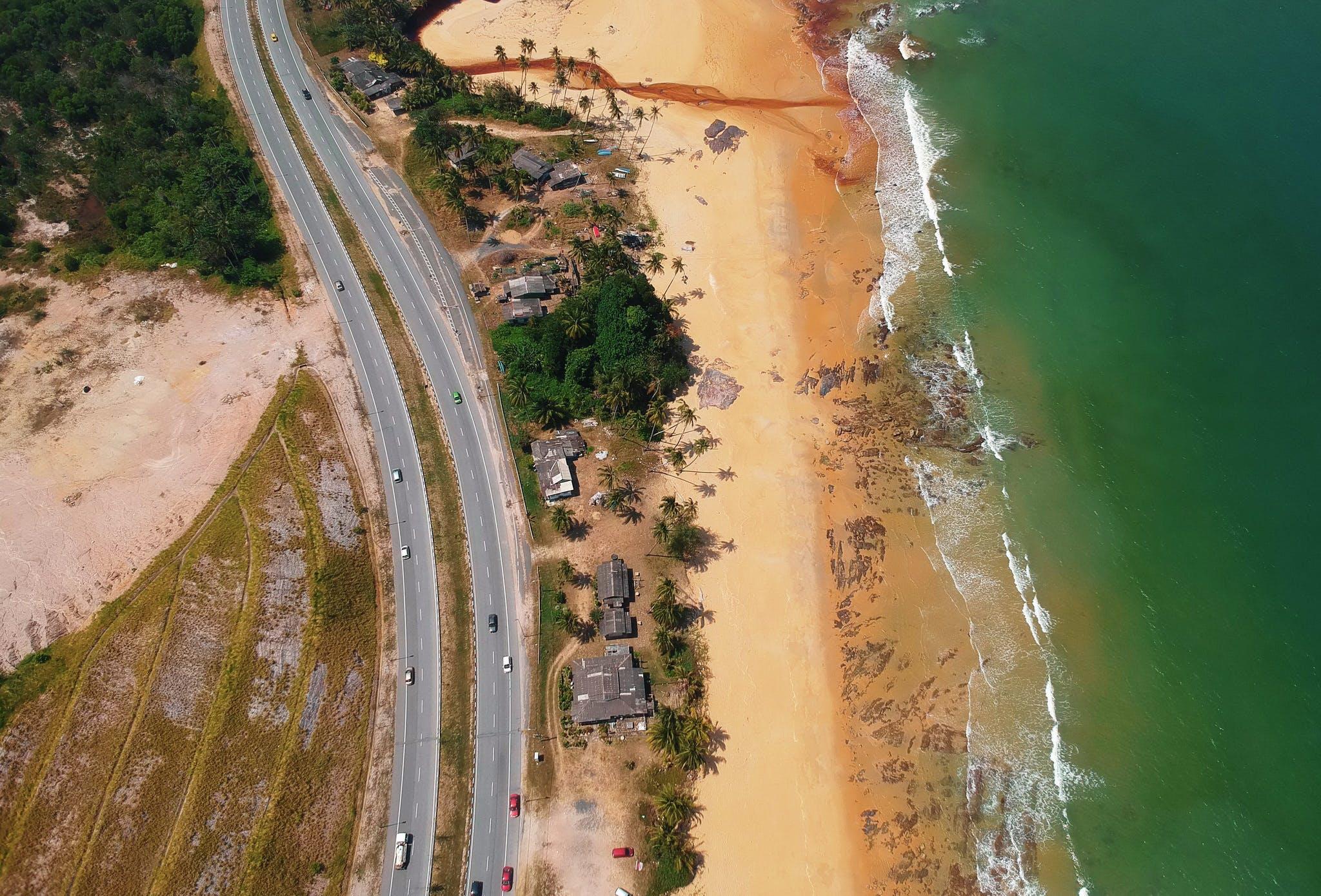 Aerial View of Road Beside the Seashore