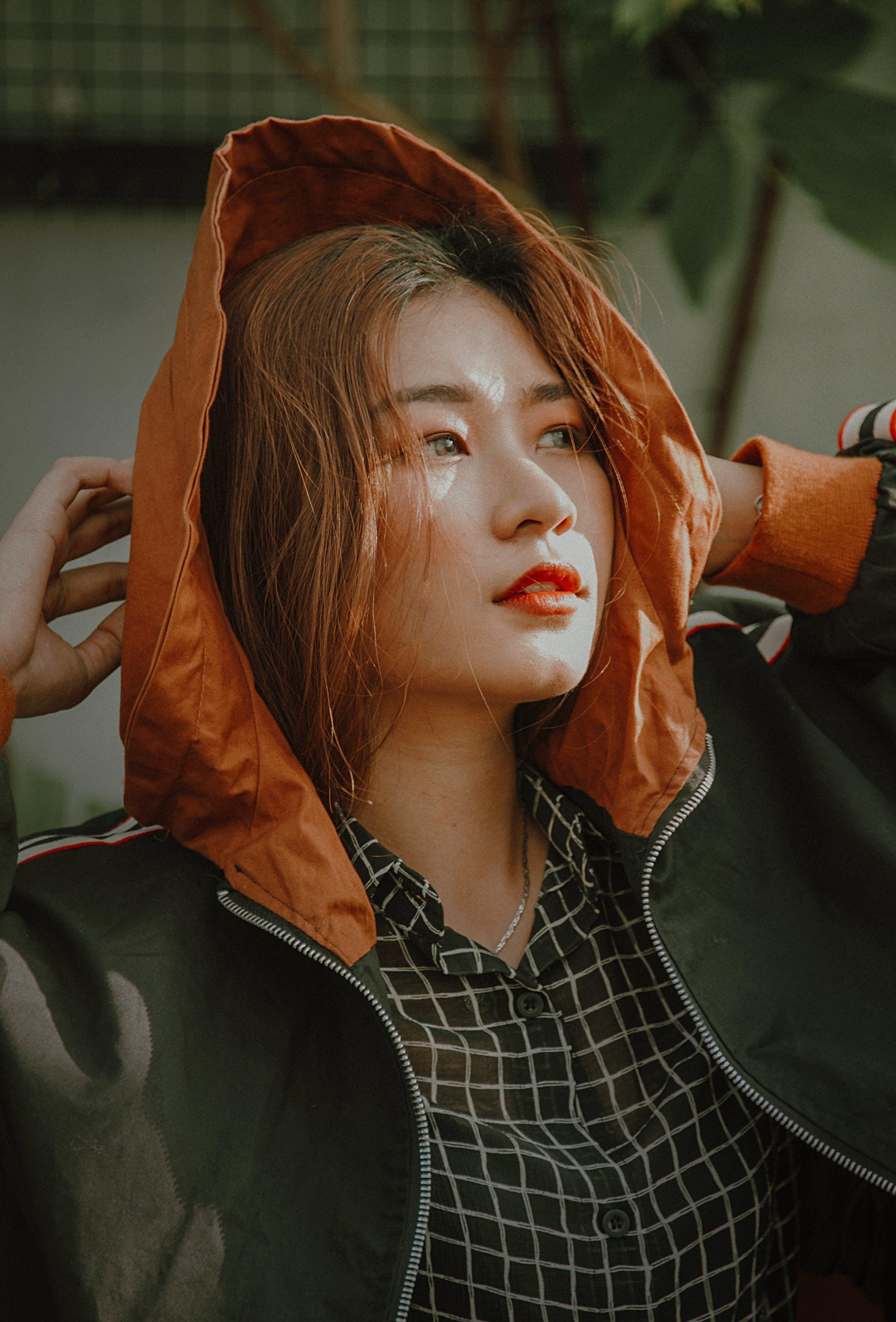 Woman Wearing Orange and Black Zip-up Jacket