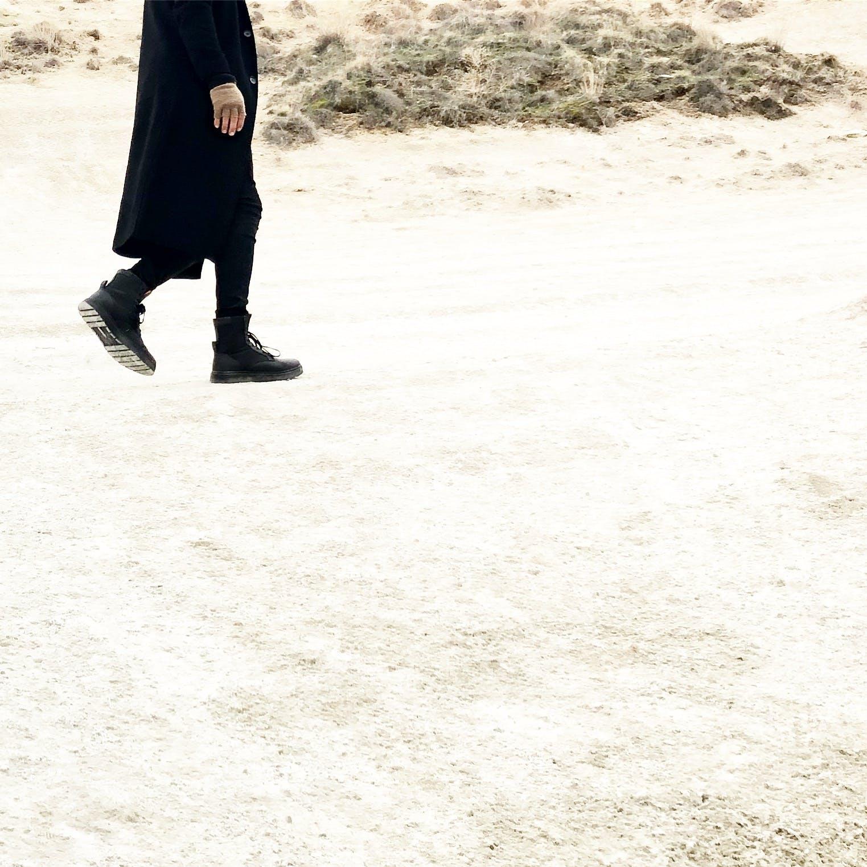 Person In Black Coat