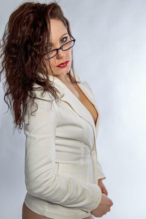 Woman in White Long Sleeve Shirt Wearing Black Framed Eyeglasses