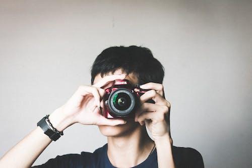 Бесплатное стоковое фото с nikon, браслет, камера, линза