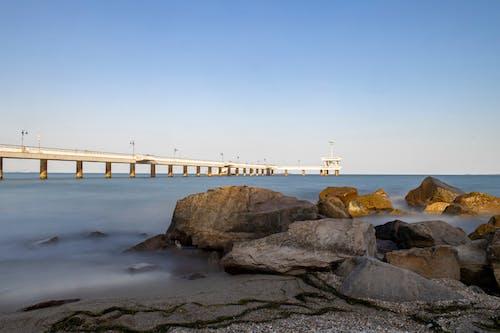 Free stock photo of beach, bridge, dawn