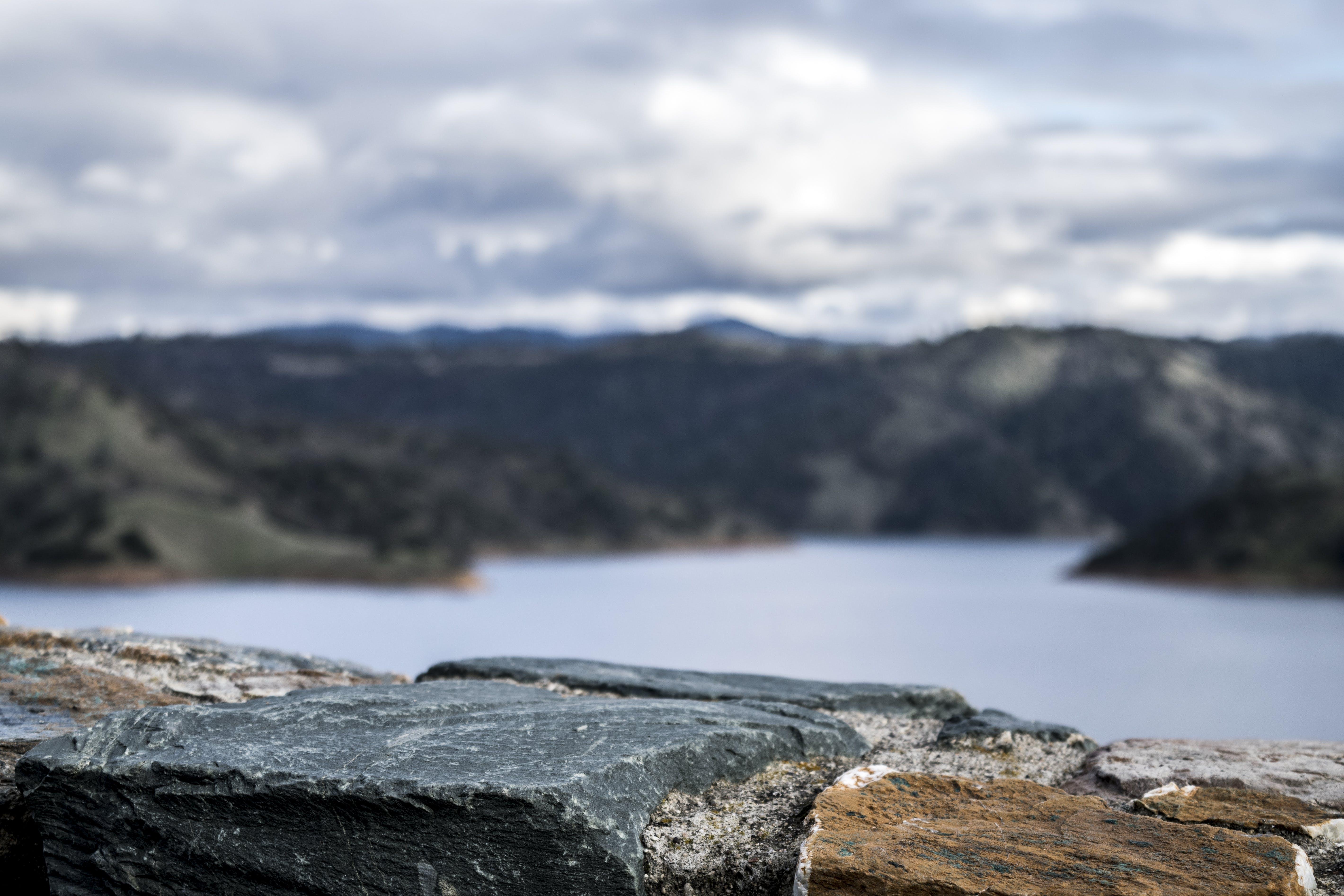Photography of Lake Between Mountain at Daytime