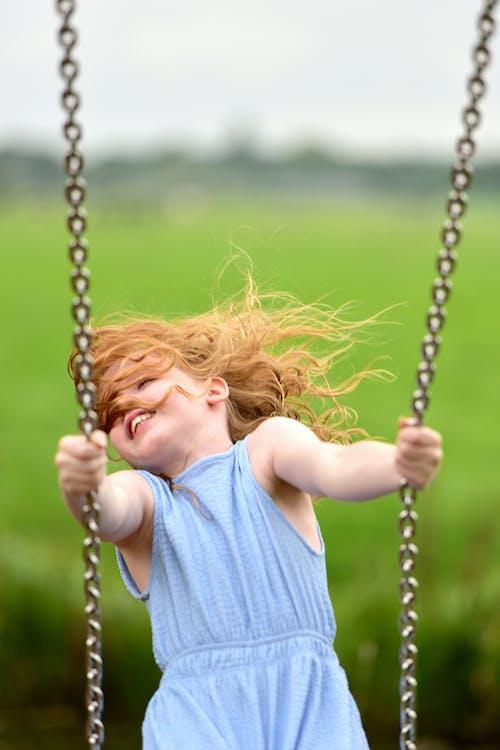 Girl in Blue Dress on Swing