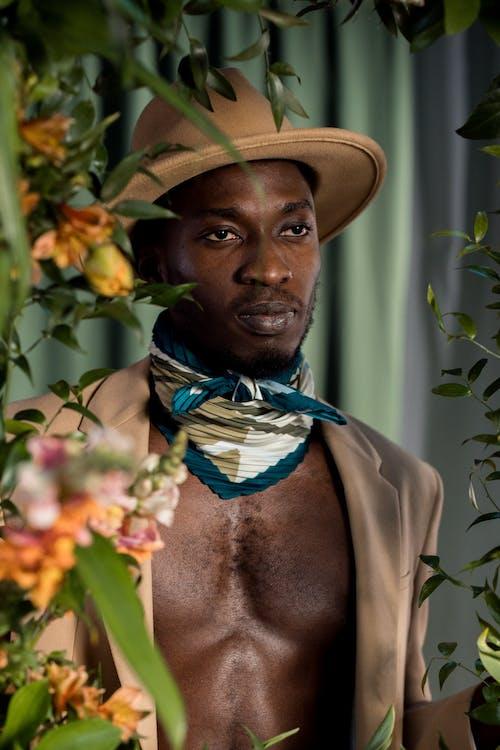Man in Brown Cowboy Hat and Brown Coat
