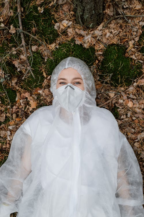 A Person Wearing Personal Protective Equipment Lying Down