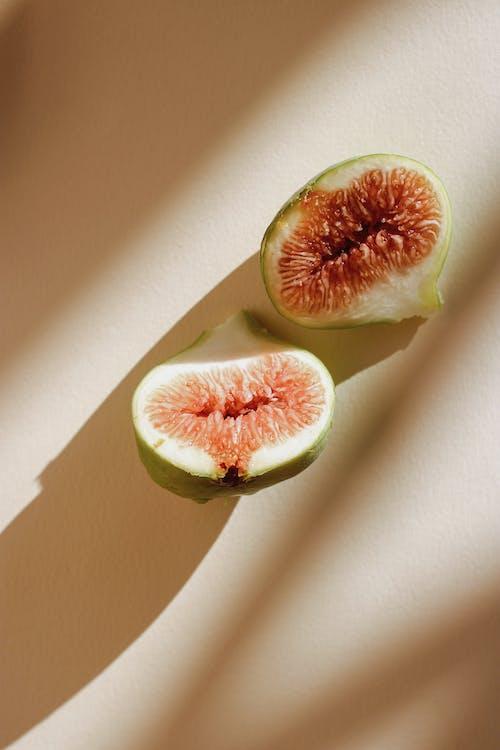 Sliced Fruit on White Table