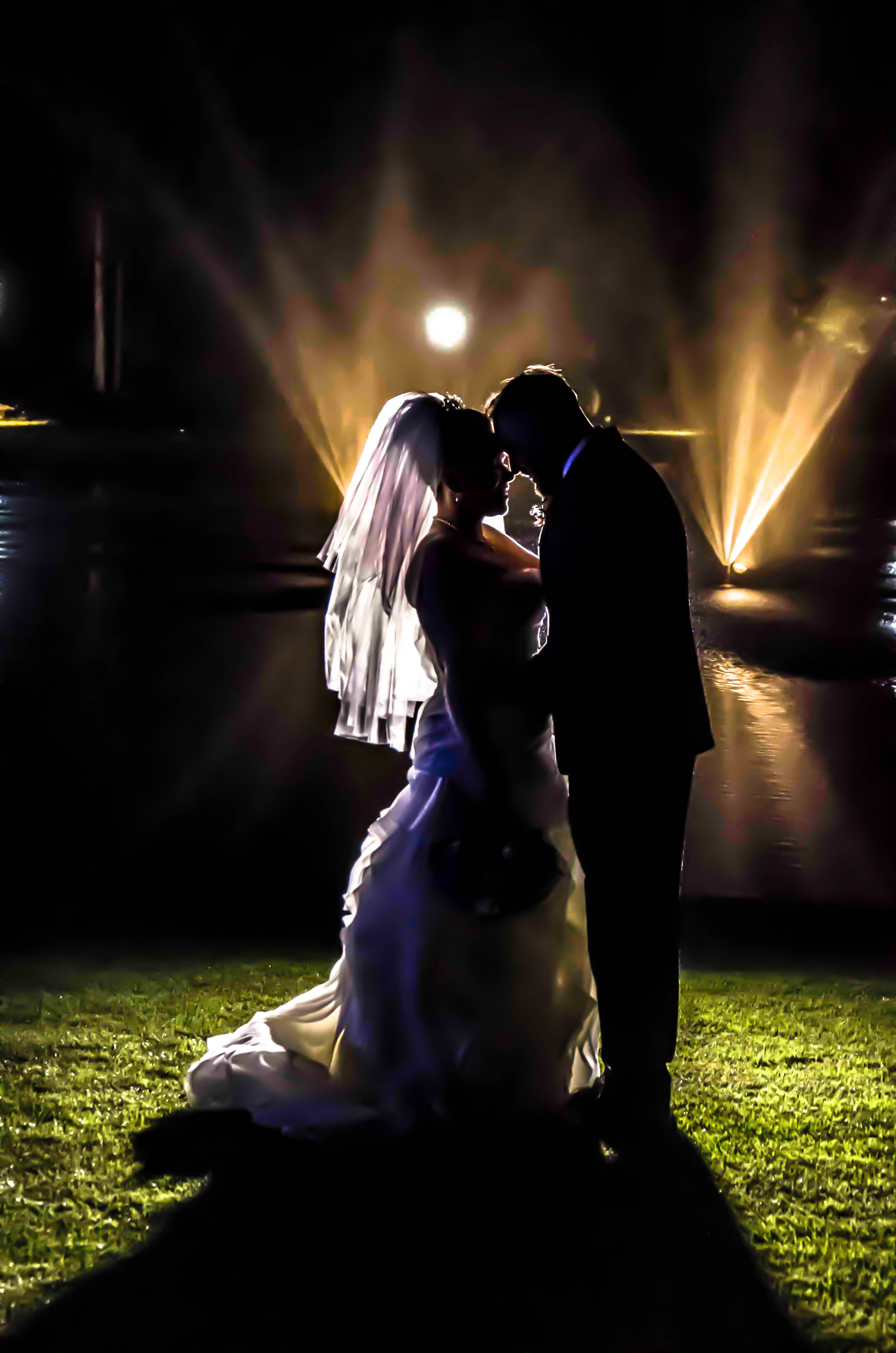Silhouette of Bride and Groom on Grass Field during Night Times