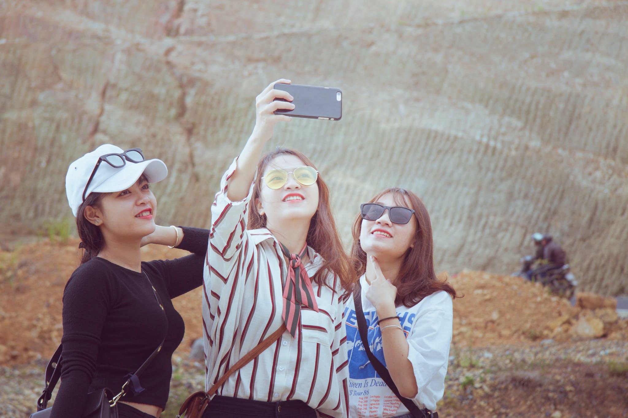 Three Woman Doing Some Selfie