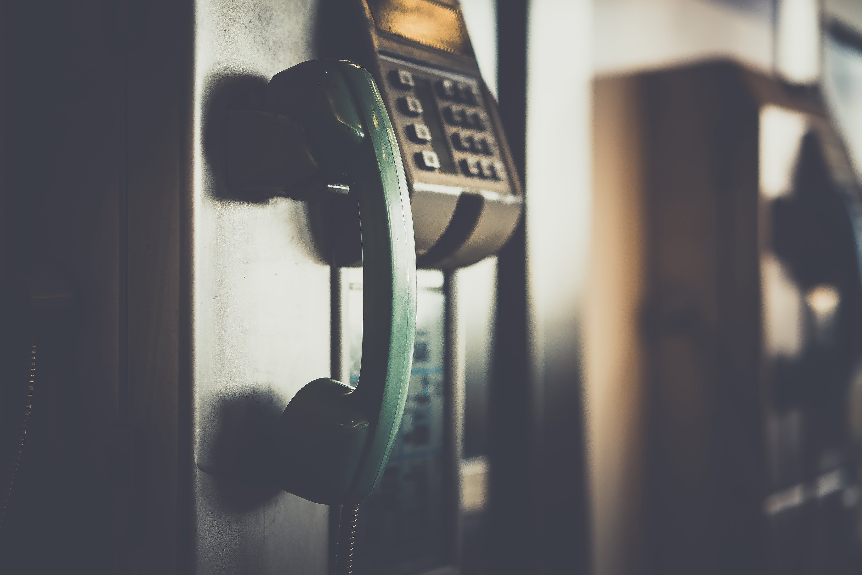 Selective Focus Photo of Green Telephone
