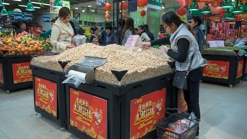 Foto profissional grátis de amendoim, China, compradores, feira