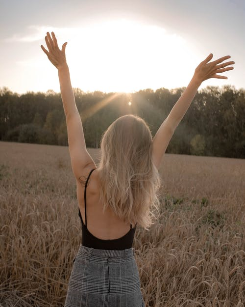 Free stock photo of adult, arms raised, blond hair