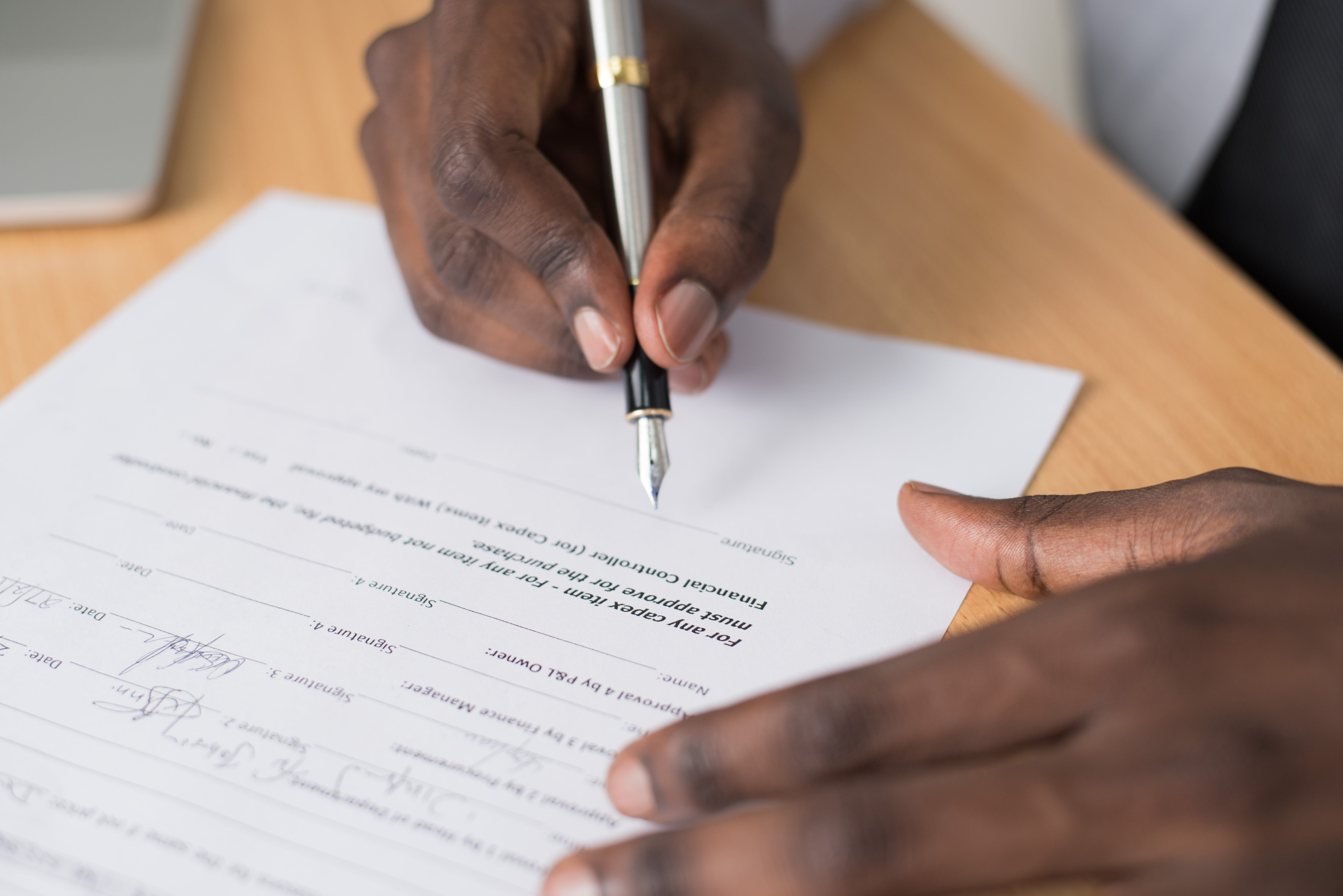 Close-up Photography of Person Writing on White Paper