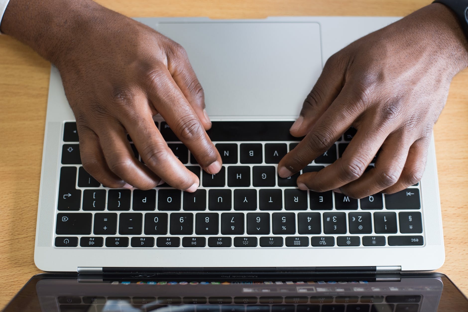 hands of a person typing laptop
